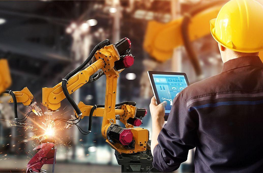 man working on robotics manufacturing