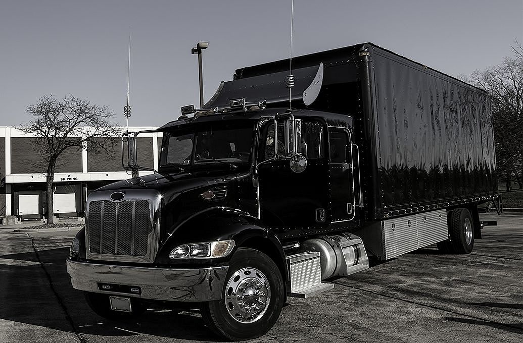black semi truck parked