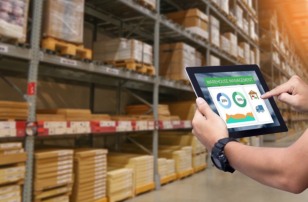holding tablet in warehouse