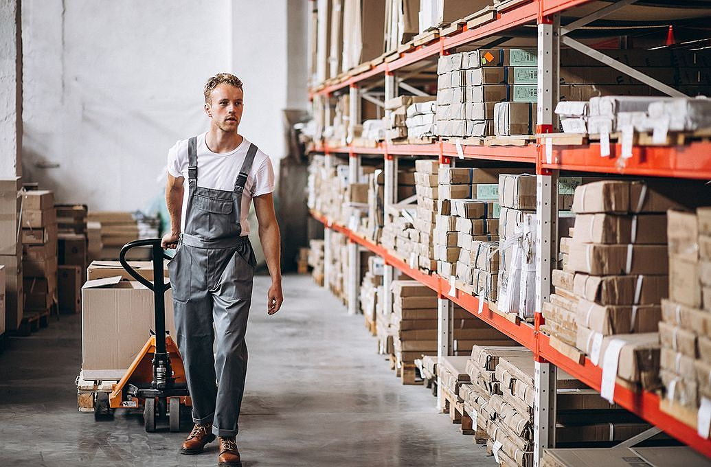 man in overalls in factory